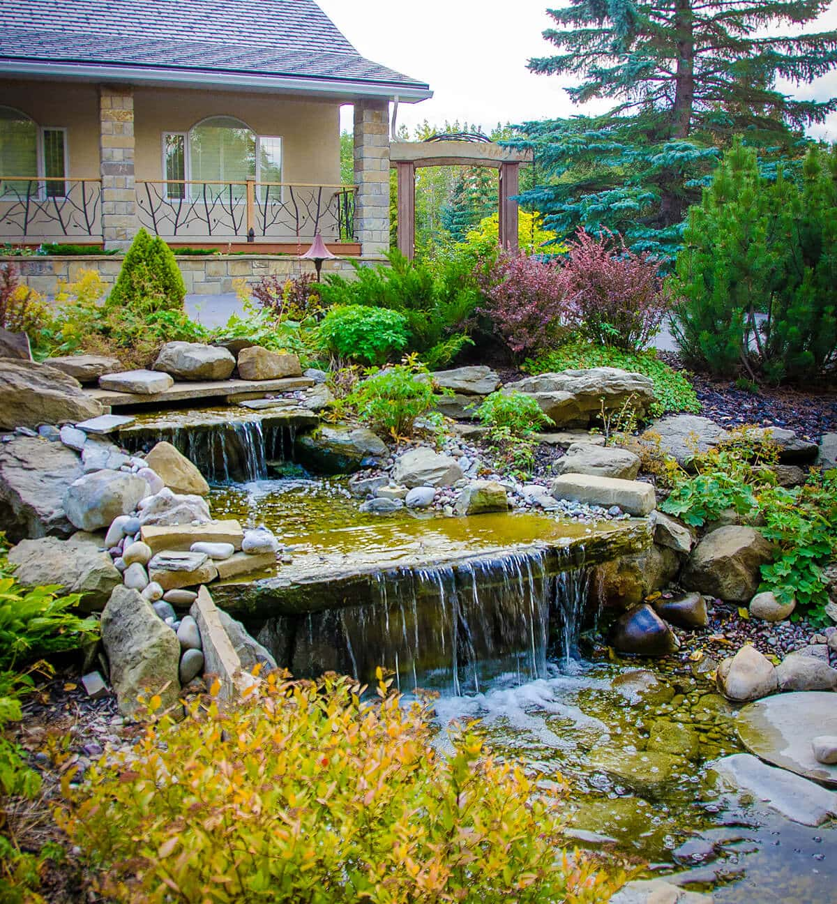 Custom yoga rock and storm water harvested pond